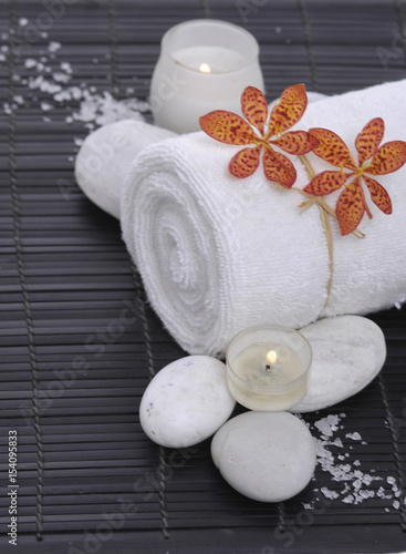 Poster Spa Spa setting with candle, towel ,orchid, ,salt on mat