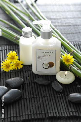 Deurstickers Spa Spa setting with candle ,oil,yellow flower ,stones ,grove on mat