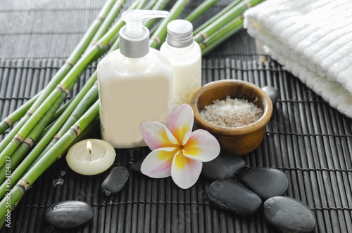 Deurstickers Spa Spa setting with candle , frangipani,towel ,stones ,grove on mat