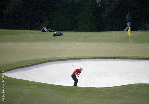 Australia\'s Adam Scott hits from the sand trap on the fourth hole ...
