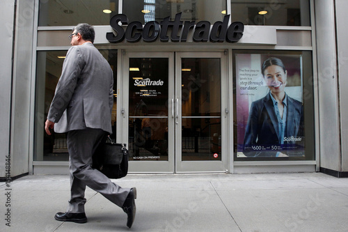 A Man Passes By Scottrade Financial Services Inc Branch In The District New York