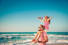 Happy Family Having Fun On Summer Vacation