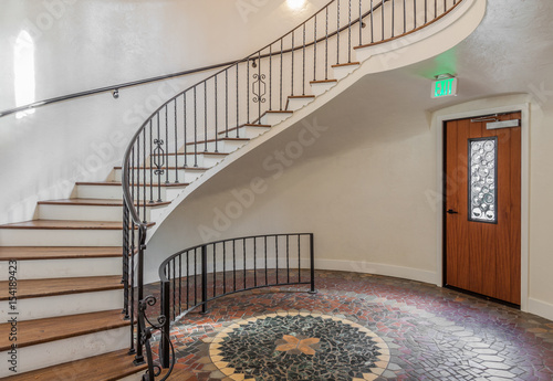 Vintage Spiral Staircase With Modern Light And Mosaic Floor