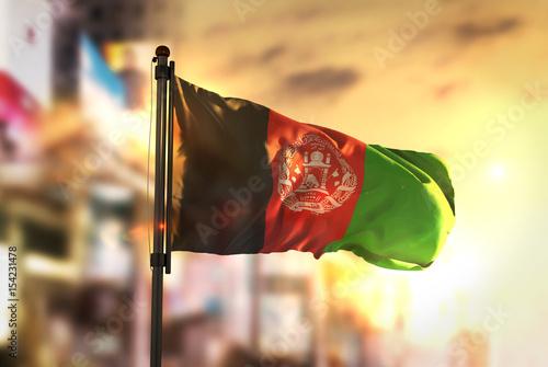 Afghanistan Flag Against City Blurred Background At Sunrise Backlight Wallpaper Mural