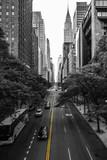 Fototapeta Nowy York - Endless streets of Manhattan New York skyscraper cars yellow lane marking black and white