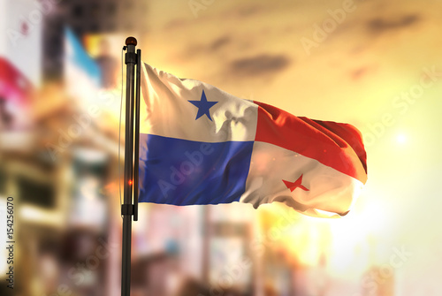 Cuadros en Lienzo  Panama Flag Against City Blurred Background At Sunrise Backlight