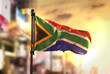 canvas print picture - South Africa Flag Against City Blurred Background At Sunrise Backlight