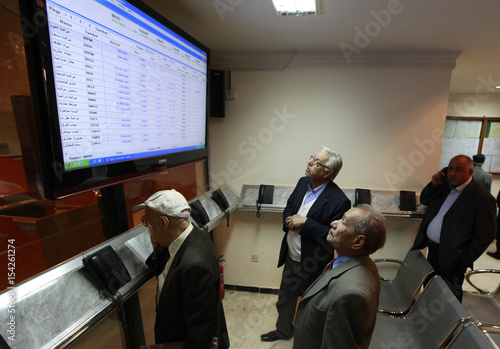 Investors Monitor Stock Information At The Iraq Exchange In Baghdad