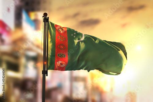 Turkmenistan Flag Against City Blurred Background At Sunrise Backlight Wallpaper Mural