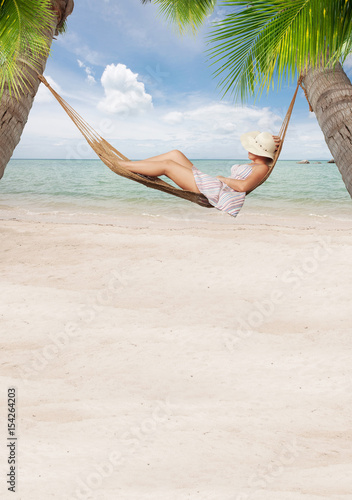 Photo  view of nice young lady chilling  in hummock on tropical beach