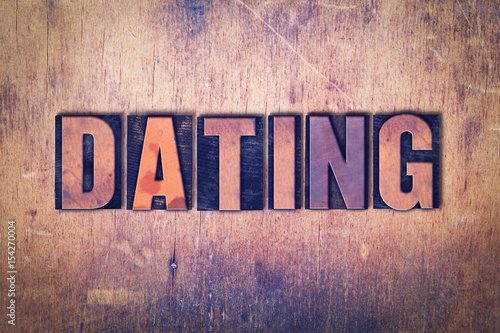 Photo Dating Theme Letterpress Word on Wood Background