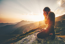 Man Praying At Sunset Mountains Travel Lifestyle Spiritual Relaxation Emotional Meditating Concept Vacations Outdoor Harmony With Nature Landscape