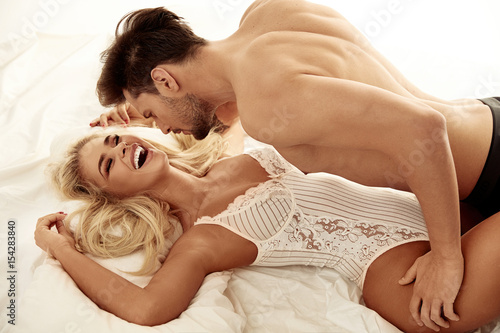 Poster Artist KB Handsome young man seducing the pretty blonde