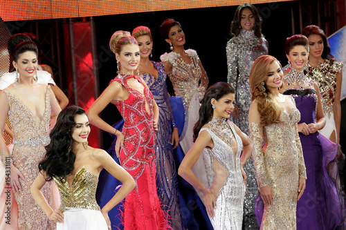 Contestants compete during the evening gown segment of the Miss ...