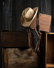 Cowboy Hat And Bridle In Barn Setting