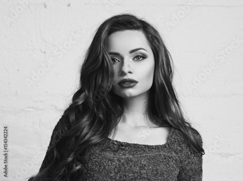 Foto op Plexiglas womenART Young beautiful gorgeous female model inpurple pullover posing against white brick wall. Stunning glamorous girl with long curly hair