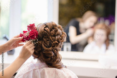 Female Hairdresser Standing And Making Hairstyle To Cute Lovely
