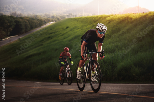 Photo sur Toile Cyclisme Cyclist in maximum effort in a road outdoors
