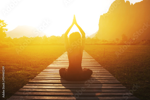 Wall mural - Serenity and yoga practicing at sunset, meditation