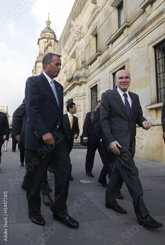 U S  House Speaker John Boehner walks with U S  Ambassador