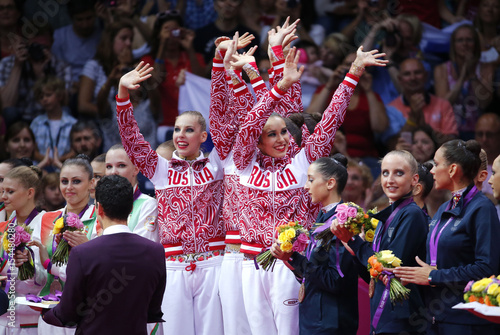 Team Russia celebrate with their gold medals with bronze medallists