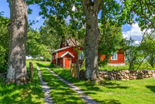 Red Cottage In A Rural Idyll