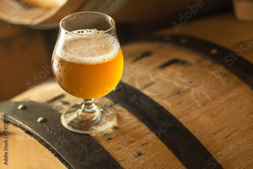 Light beer on a barrel - 154513819