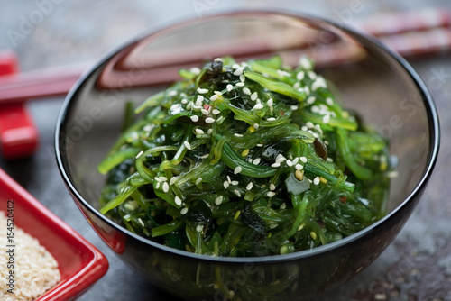 Close-up of seaweed salad topped with sesame seeds, selective focus, horizontal shot