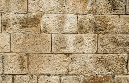 Old sandstone blocks stonewall closeup as background Wallpaper Mural