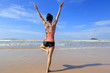 Young fitness woman wear swimsuit practice yoga on the beach