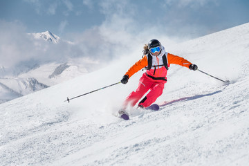 Female skier on a slope in the mountains
