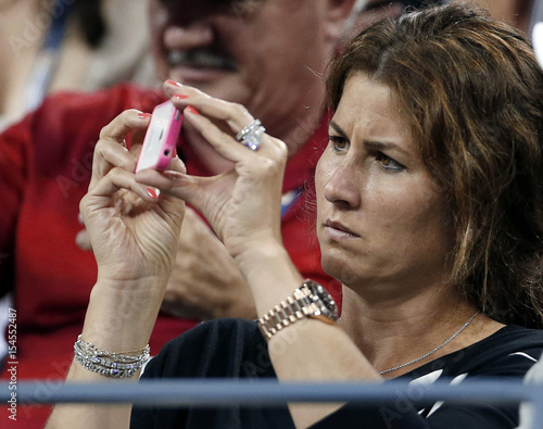 Mirka Wife Of Swiss Tennis Player Federer Uses Her Iphone To