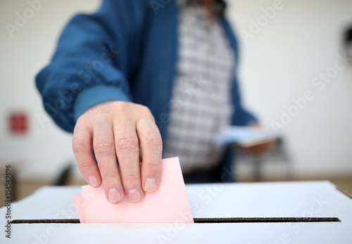 Fotografie, Obraz  Man casts his ballot at elections
