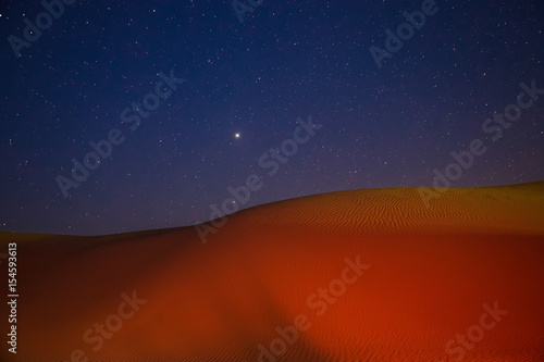 Barkhan dune, starry night in the desert of Kazakhstan