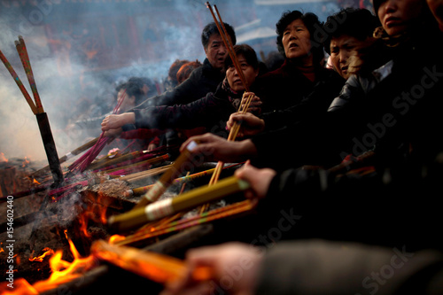People burn incense to pray for good fortune on the first day of the