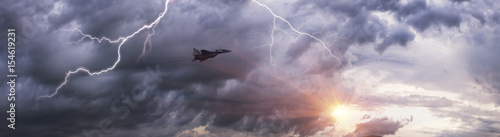 plakat Soviet fighter and thunderstorm