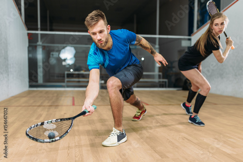 Squash game training, players with rackets