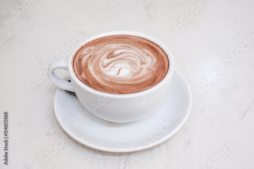 hot cocoa and milk foam on wooden table