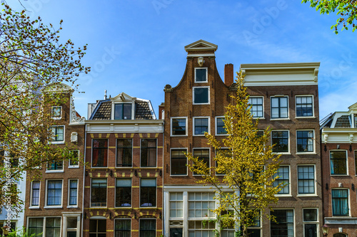 Classic city houses in Amsterdam, street view Wallpaper Mural
