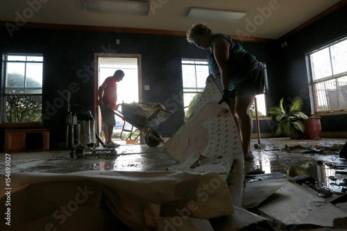 sharon bogan and her son kevin remove drywall from their flooded