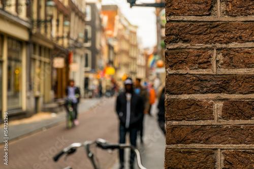 Photo  Peeking around the corner in Amsterdam