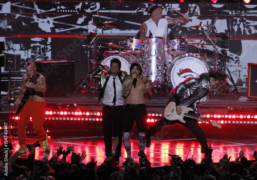 Mars performs with The Red Hot Chili Peppers during the