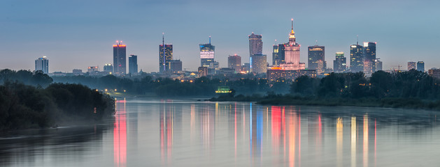 Panel Szklany PodświetlaneNight panorama of Warsaw skyline, Poland, over Vistula river in the night