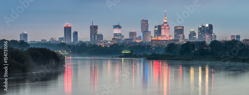 Spoed Foto op Canvas Panoramafoto s Night panorama of Warsaw skyline, Poland, over Vistula river in the night