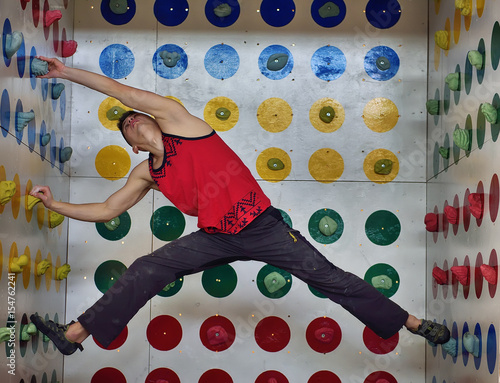 Fotografie, Obraz  man playing in climber twister