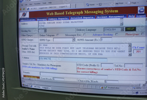 A computer screen shows a telegram message inside the central