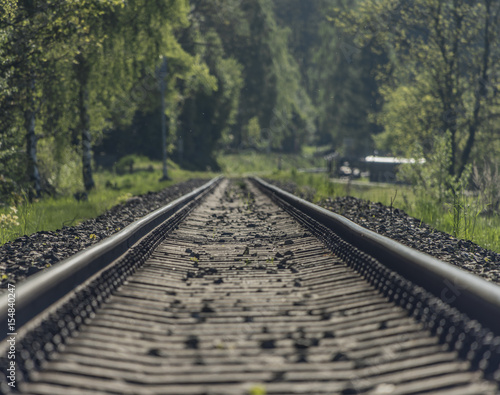 Photo Stands Railroad Railway track in spring fog sunny day