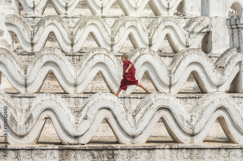 The young monk are running and jumping on the Mya Thein Tan Pagoda at bagan, man Poster