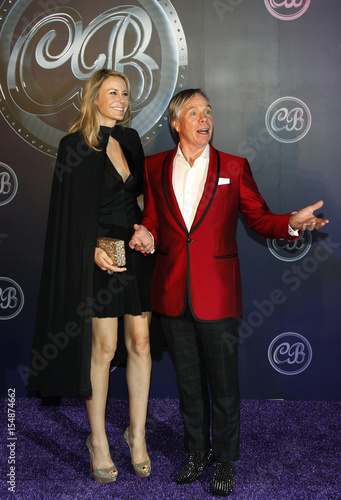 8fe0cac1 Fashion designer Tommy Hilfiger and his wife Dee Ocleppo pose on the red  carpet in Hong Kong
