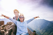 canvas print picture - Two happy friends on top of a mountain. Happiness, freedom, travel